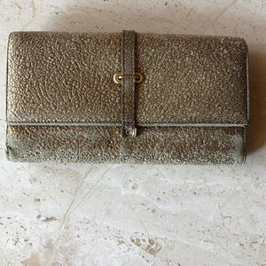 6cd4608449f Yves Saint Laurent Accessories - YSL Yves St. Laurent Gold Pebbled Leather  Wallet